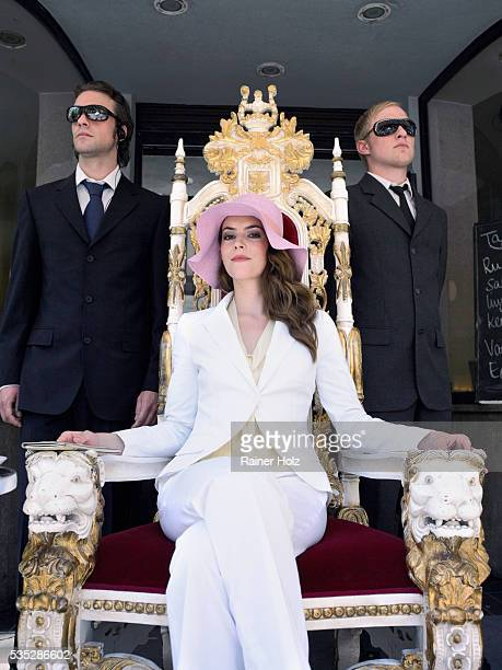 woman on throne with security guards - throne stock pictures, royalty-free photos & images