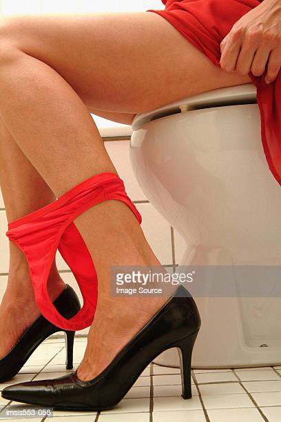 Woman on toilet seat