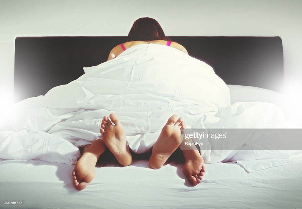 Woman on top. Anonymous couple having sex : Stock Photo
