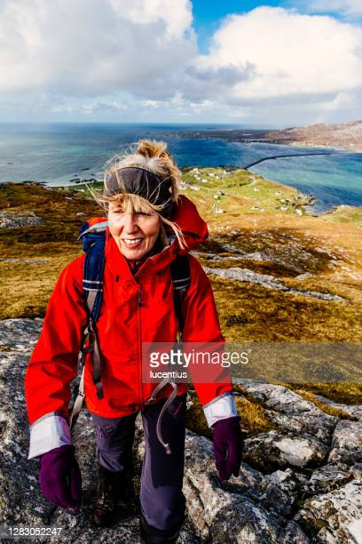 woman on top of island of eriskay, scotland - walking stock pictures, royalty-free photos & images
