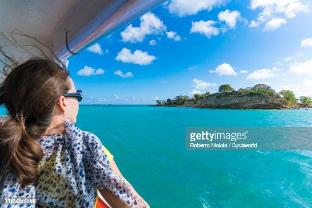 woman on tour boat, fort james, antigua - tourboat stock pictures, royalty-free photos & images