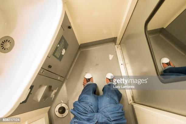 Woman on train toilet