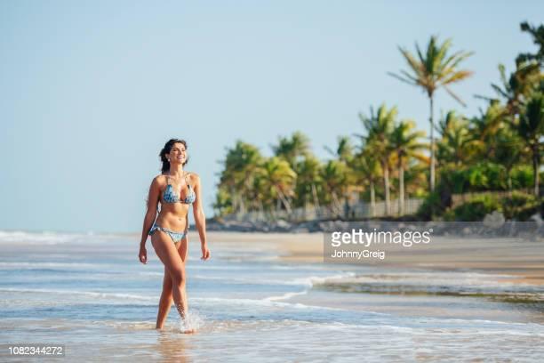 woman on tropical beach in bikini - trancoso imagens e fotografias de stock
