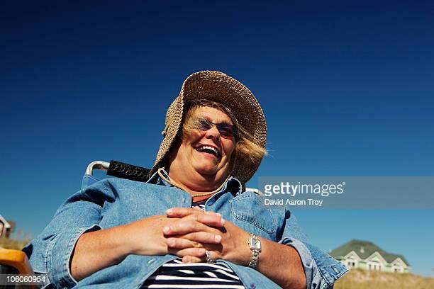 a woman on vacation, laughing. - dicke frauen am strand stock-fotos und bilder