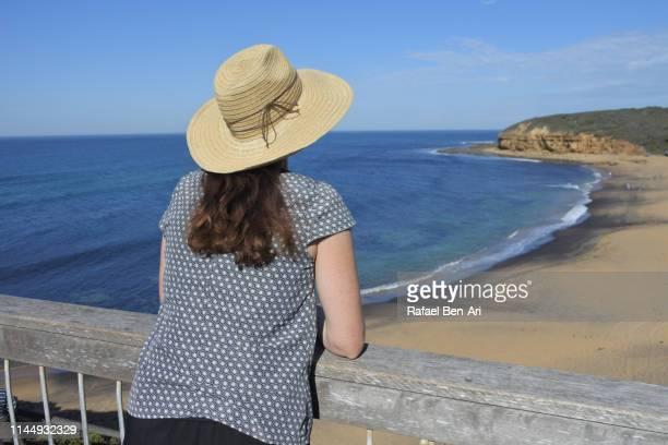 woman on vacation looking at landscape view of a beach - rafael ben ari bildbanksfoton och bilder