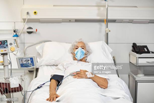 woman on ventilator in hospital during covid-19 - illness stock pictures, royalty-free photos & images