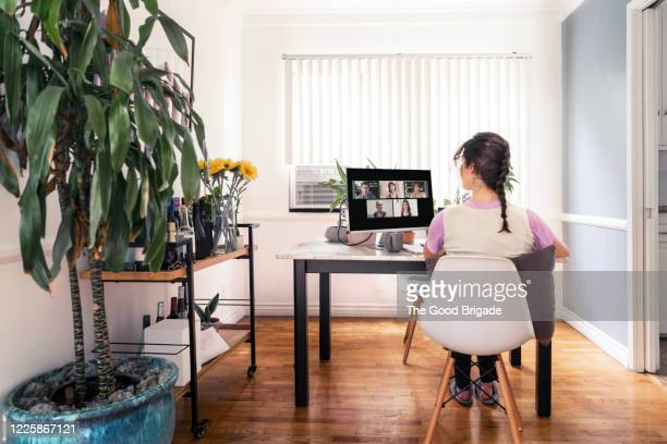 woman on video conference call with colleagues at home - working from home stock pictures, royalty-free photos & images