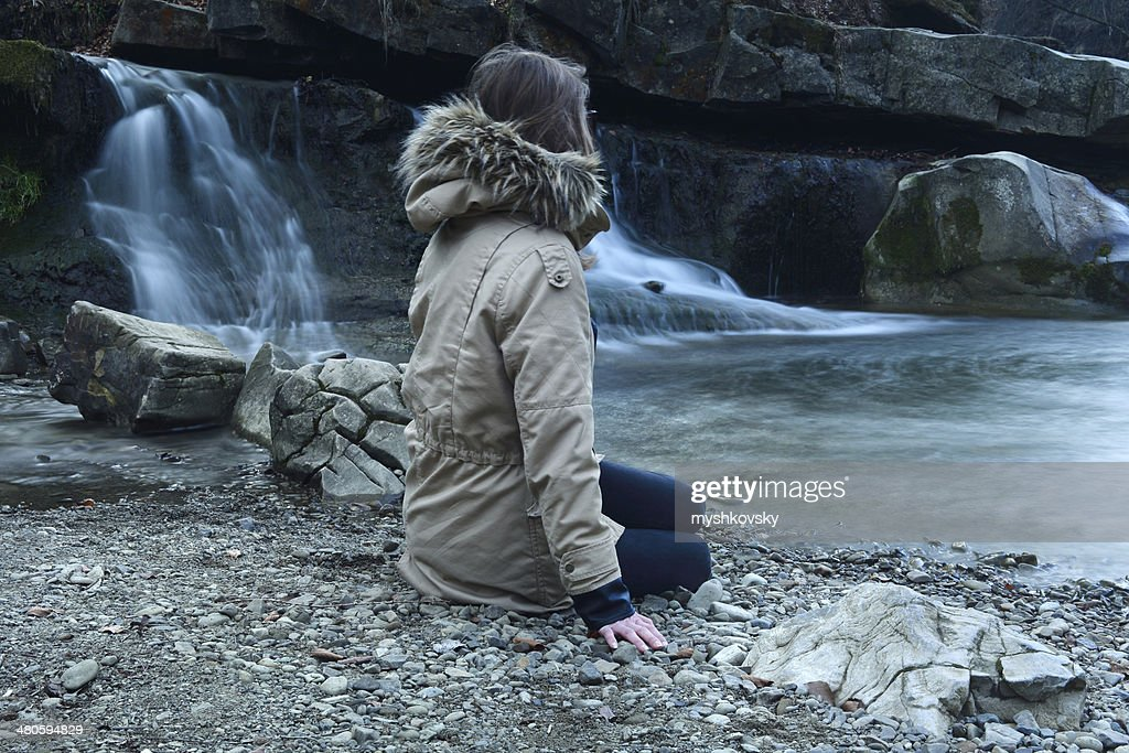 Woman on waterfall background : Stock Photo