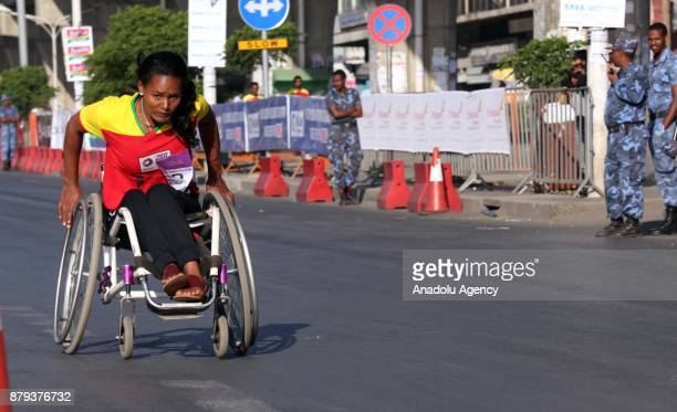 A woman on wheelchair competes in the Great Ethiopian Run at Adwa Square in Addis Ababa Ethiopia on November 26 2017 Total of 44000 professional and...