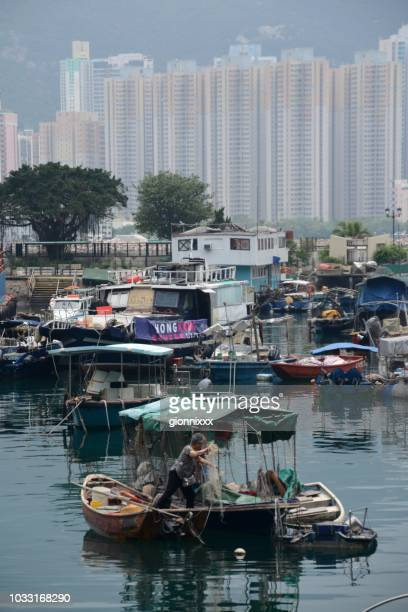 woman on wooden fishing boat at lei yue mun village, hong kong - old women in pantyhose stock photos and pictures