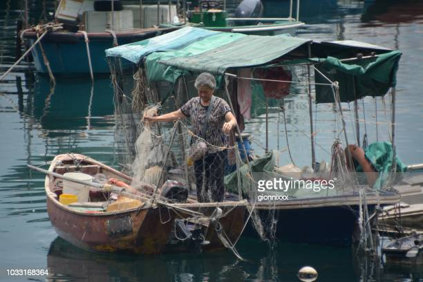 woman on wooden fishing boat at lei yue mun village, hong kong - old women in pantyhose stock pictures, royalty-free photos & images