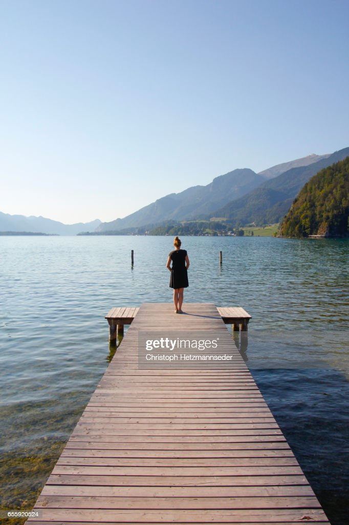Woman on wooden pier : Stock Photo