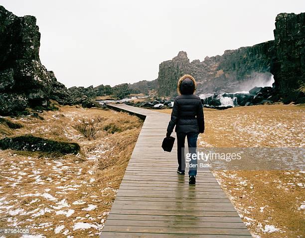 Woman on wooden walkway