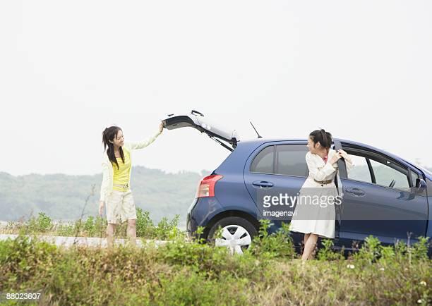 Woman openig a car door