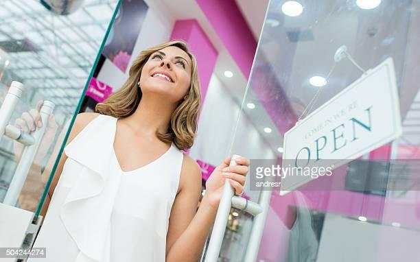 Woman opening a beauty store
