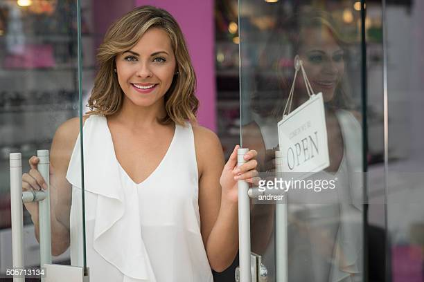 woman opening a beauty store - beauty care occupation stock photos and pictures