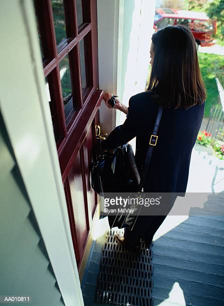 Woman Opening a Front Door