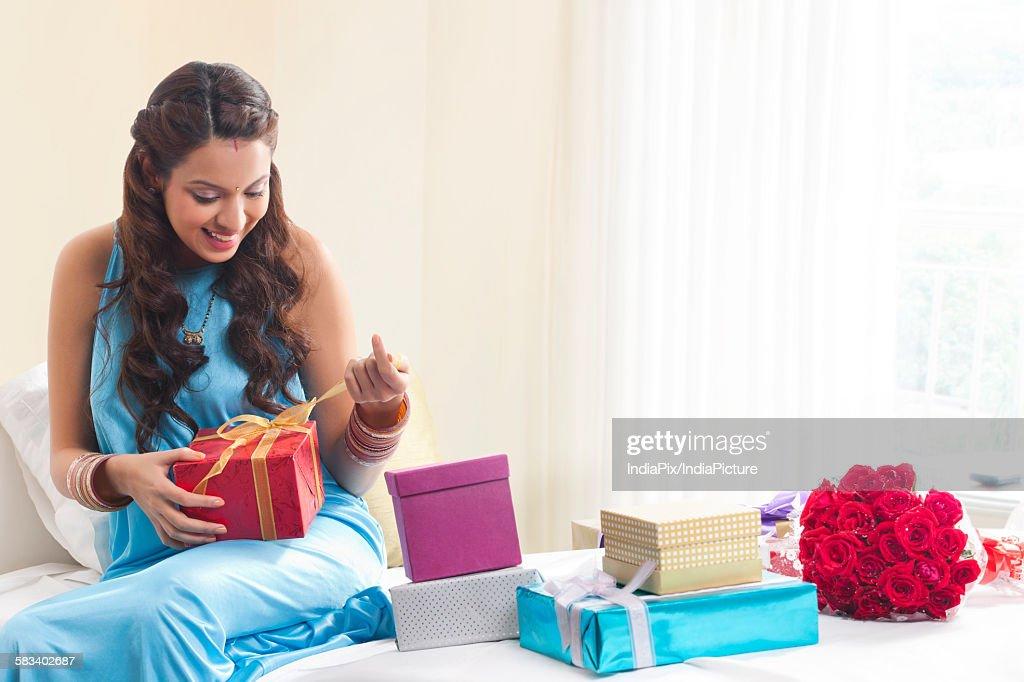 Woman opening a gift box : Stock Photo