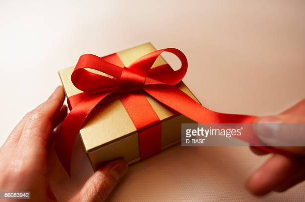 woman opening a present box