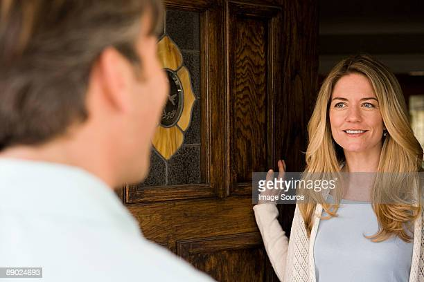 woman opening door - answering stock pictures, royalty-free photos & images