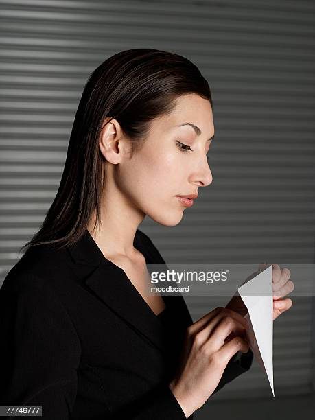 Woman Opening Envelope