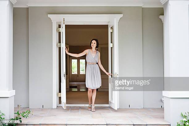 Woman opening french doors