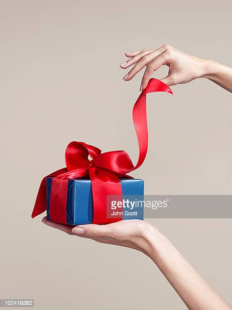 woman opening gift, close-up of hands - gift stock pictures, royalty-free photos & images
