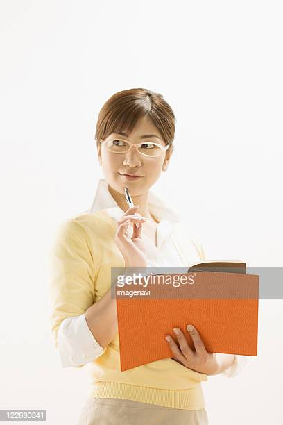 Woman Opening Notebook