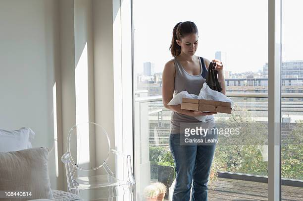 Woman opening parcel
