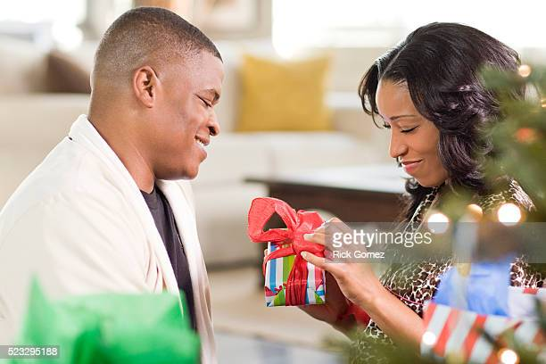 woman opening present - african american christmas images stock pictures, royalty-free photos & images