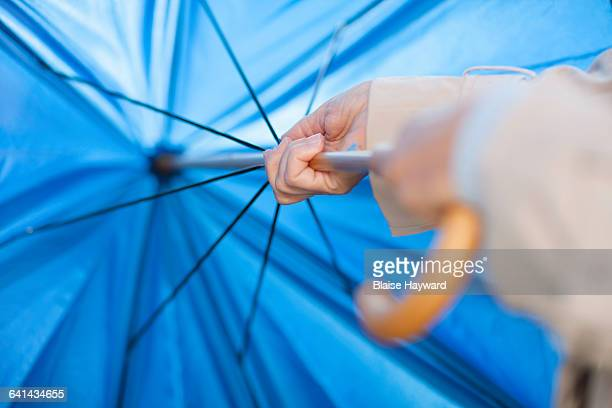 woman opening umbrella - umbrella stock pictures, royalty-free photos & images