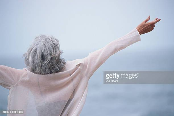 Woman Opens Arms to Ocean