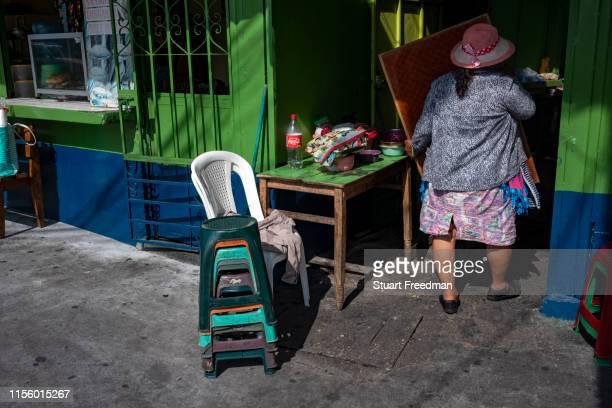 Woman opens her shop selling street food in Guatemala City, Guatemala.