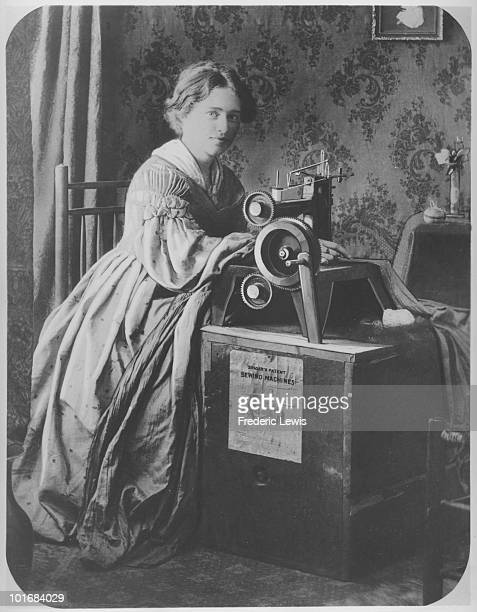 A woman operating a Singer patent sewing machine USA circa 1860 The machine sits on a crate labelled 'Singer's patent sewing machine'