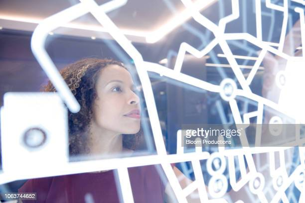 woman operating digital interface technology - innovation stock pictures, royalty-free photos & images