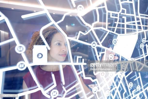 woman operating digital interface technology - verkehrswesen stock-fotos und bilder