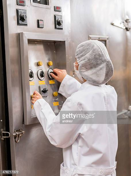 Woman operating machine at a food factory