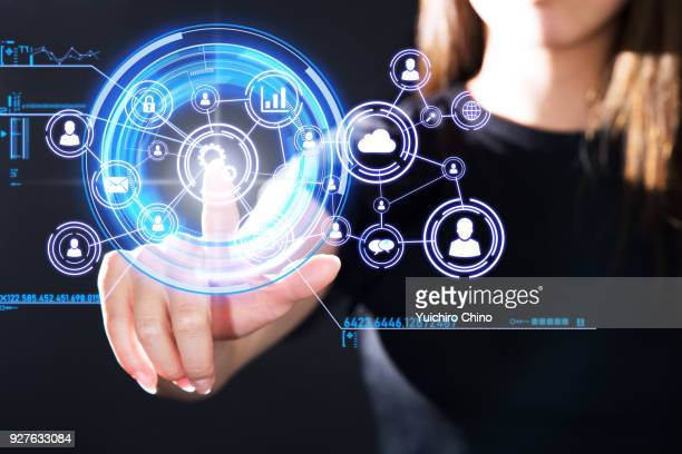 woman operating the digital interface technology - marketing icons stock photos and pictures
