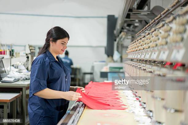 woman operating the embroidery machine - textile factory stock photos and pictures