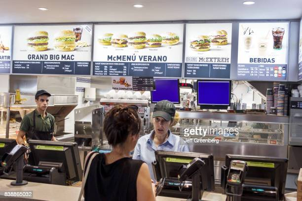 A woman ordering food at McDonalds in Plaza de Zocodover