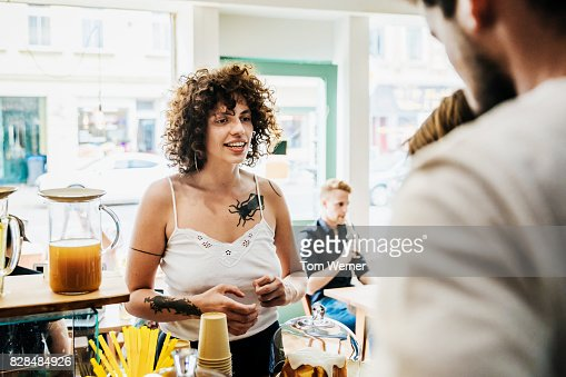 A Woman Ordering Something To Eat From Counter At Coffee Shop