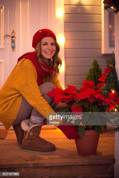 woman outdoors at winter. - poinsettia stock photos and pictures