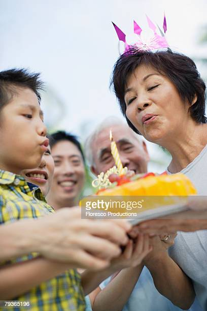 Woman outdoors celebrating birthday with family