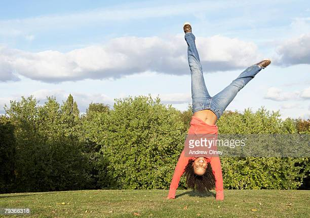 Woman outdoors doing a cartwheel