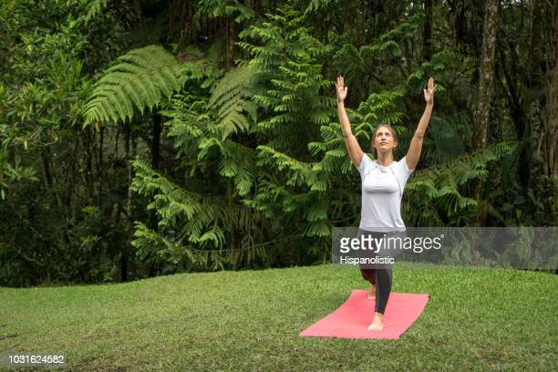 Woman outdoors doing yoga and relaxing