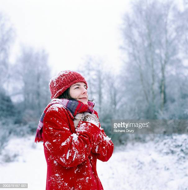 woman outdoors, hands to chest, winter - weather stock pictures, royalty-free photos & images