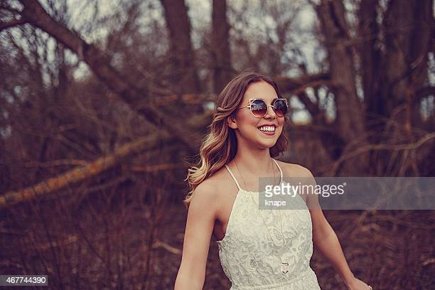 Woman outdoors in spring nature with fashionable sunglasses