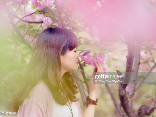 Woman Outdoors In Springtime
