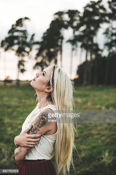 Woman outdoors in summer with long beautiful hair