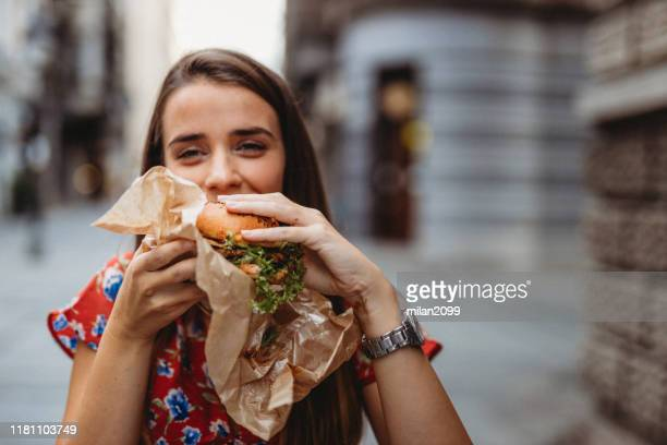 woman outdoors - veggie burger stock pictures, royalty-free photos & images
